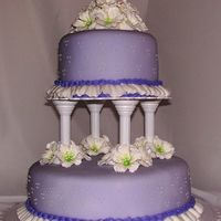 Lavendar Wedding Cake Round, 2 tier wedding cake with lavendar fondant. Top tier chocolate fudge cake with Wilton's chocolate icing as filling. Bottom tier...