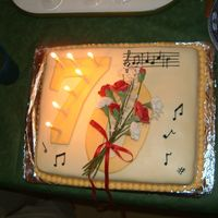 70Th Birthday Cake For Music Lover hand made sugar paste flowers adorn the O on 70. Musical notes for happy birthday on top corner