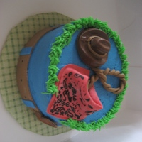 Cowboy Theme Cake   Buttercream icing with fondant accesories