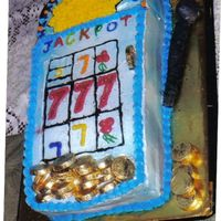 Slot Machine I had fun doing this cake. It's two 9x13's and half of a 9 inch. It's iced in buttercream with strawberry filling. This was...