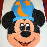 Mickey Mouse Sorcerer Birthday Cake   We also made this for the sorcerer party. This was made with a Mickey Mouse pan and an extra Sorcerer's hat cut from another cake.