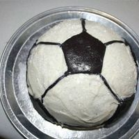 Soccer Ball Cake  Betty crocker pan (filled with chocolate pudding) I made this for our end of the season cookout today using marshmellow fondant for the...