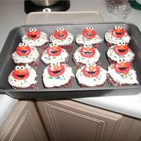Elmo Ring Cupcakes For Preschool Class   We had an elmo themed birthday and made these cupcakes with rings on top for the class at preschool.