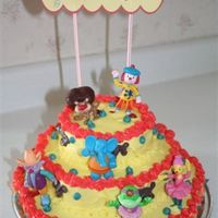 Jojo Circus Birthday Cake  Layered birthday cake for my son who is a huge JoJo circus fan (disney) Figures are toys and colors were fun to create. He loved it and can...