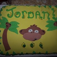 Monkey Cake vanilla caramel cake with chocolate cream cheese frosting. all decorations are satin ice!