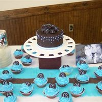 Sister's Baby Shower Cake yellow and chocolate cupcakes, with a 6-inch yellow cake to match. chocolate fontdant on cake and toppers for cupcakes. dots are royal,...
