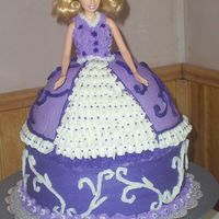 Purple Doll A doll cake fo my daughters birthday party. This is my second doll cake. I LOVED the result, as did she.