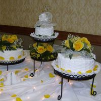 Wedding Cake W/fresh Yellow Roses White cake w/whipped cream frosting. So easy to work with. I've been taken classes in the cake decorating store and have made cakes...