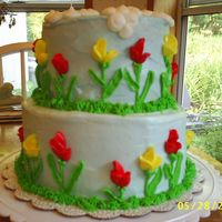 Sweet Pea/tulips And Clouds My sister made this cake for my 31st birthday. All the decoration was buttercream. The cake was white with a decadent coconut filling. My...