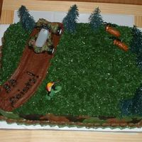 "Dh's Birthday Cake I had a lot of fun doing this cake! It turned out very well. This is the first time I've done a ""multi-colored"" border. This..."