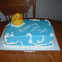 First Baby Shower Cake This was supposed to have the 3-d ducky cake on it, but it fell over, smashing half of the cake and the duck, so I just went with this...