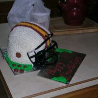 My First Football Helmet I did this one for my nephew for his 11th Bday. I used the color for the local team he plays for. this was my first attempt...I thought it...
