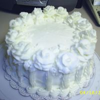 Simple White All buttercream. Modeled after a Wilton cake.