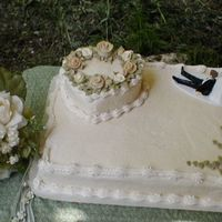 Wedding Cake buttercream with fondant hand made roses, painted to match brides bouquet