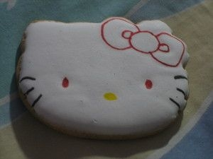 Tired Kitty at 3 am while making the cookies and my cakes i made a hello kitty with red eyes...kept me awake for a few more minutes :D
