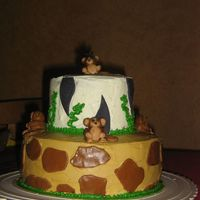 Monkey Themed First Birthday Cake  I was inspired by a couple of jungle themed cakes on this site for this cake. I made the birthday boy a banana shaped smash cake to...