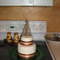Little Holiday Cake   I made this cake for a secret santa exchange, its the white almond sour cream cake with strawberry cream cheese filling, frosted with BC.
