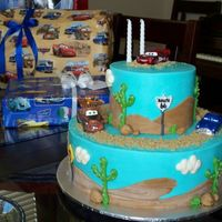 My Son's 2Nd Birthday Cake Buttercream with fondant hills, rocks, and street signs. Thanks cake central-ers for the inspiration!