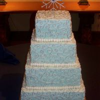 Vealy/stieger Cake Light blue buttercream with silver scrolls