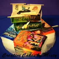 Harry Potter Series  Each book is a seperate cake. All books are covered in Satin Ice, air brused, and the pics are not edible images, they are printed onto...
