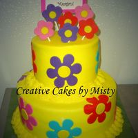 Daisies   all buttercream with fondant accents. Fondant daisies dried and attached to lollipop sticks with candy melts.