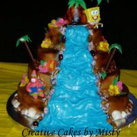 Sponge Bob Luau  All buttercream with fondant waterfall and accents. Candy mold shells and plastic figurines. For my 2 year old DAUGHTER!!!!! had a horrible...