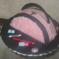 Purse first purse cake. Lemon curd and covered in chocolate clay and fondant makeup.