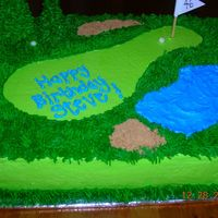 Golf Cake 1/4 sheet cake. Devils food w/ bcd icing. I got this order the day before it was due and he wanted something golf related. I got this idea...