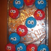 Elmo And Cookie Monster Cupcakes   I made these cupcakes for my daughter's 2nd birthday. She loves Sesame Street.
