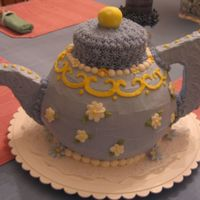 Teapot Cake This is my first 3D cake! My best friend (also my cake decorating partner) and I created the handle and spout out of styrofoam, covered...