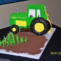John Deere The bride wanted a stand up John Deere tractor with a Corn field.