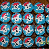 Pirate Cupcakes For my son to take to school for his bday. Jolly rogers made from fondant and color flow