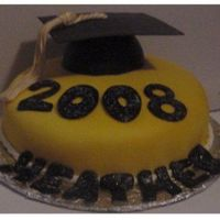 2008Gradcake.jpg Fondant covered cake with airbrushed fondant accents. Edible glitter was sprinkled on to the black numbers and letters while they were...