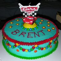 Cars B-Day Cake This was the 3rd cake I've ever done. It is all buttercream and accented in mini M&M's. This was for my friends kid who just...