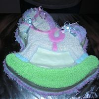 Horse Of A Different Color This was done for a friend's baby shower. I used Lt blue and ping for the mane and tail and lt blue and ping pacifiers with bows to...