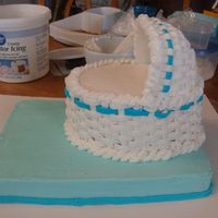 Bassinet Baby Shower Cake This is a chocolate cake covered in buttercream and the cover peice is fondant molded in half of a 3-D egg pan then covered with...