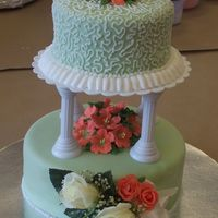 Wilton Course 3 Final Prjoect A tiered cake covered in fondant. The white roses in the front is a corsage that was given to me from my Mother-in-law, the peachy roses...
