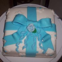 Wilton Course 3 Class 2 8 in. cake covered in fondant with first fondant rose and fondant bow.