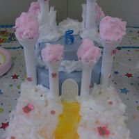 Castle In The Clouds This castle was my daughter's 5th birthday cake. It was supposed to be a castle in the clouds theme. The clouds were made of cotton...