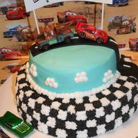 Disney Cars Birthday Cake. Chocolate bottom tier white white top tier. BC frosting with fondant road.