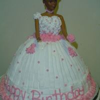 Stand-Up Doll Birthday Cake African American doll cake with buttercream icing.