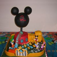 Mickey Mouse Club House Buttercream icing, with mmf detail and designs around the entire cake. The entire cake is edible except for Mickey's oversized head...