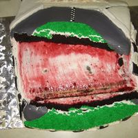 My 1St Cake-Tastophy Nascar theme, just slid right off and broke in two. I only made it to the end of my street. Luckily it was for a close friend who was ok...