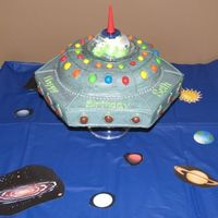 Alien Spaceship Cake This was fun. Got ideas from CC. Used hexegon shaped pan for bottom. There is an alien inside the plastic dome but you can't see it...
