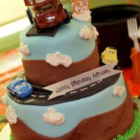 Disney Cars Cake This was inspired by several similiar cakes in the gallery. It's two layers, bottom is chocolate with cookies and cream filling and...