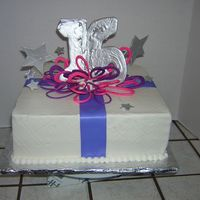 Purple And Pink Sweet 16 This customer wanted a purple and pink cake with a touch of silver on it. This is what I came up with and they loved it, The loops are made...