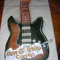 Electric Guitar  This was my first guitar cake. My cusomer gave me a picture of her sons guitar and I tried my best to duplicate. It's all BC and air...