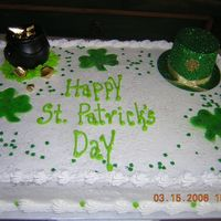St Patties Day Cake  Just something I came up with for St Patties day, I used a shamrock cookie cutter then airbrushed the inside green. The hat and kettle I...