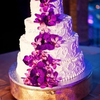 "Purple Orchid Scrolled Wedding Cake  All buttercream, iced and piping. The flowers are fresh orchids. This photo is from the wedding photographer, not me. 6""/9""/12&..."