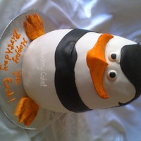 "Madagascar Penguin Cake Fondant covered, modeling chocolate beak and feet. Three 8"" layers, one 7"", one 6"" - all rounds, carved to shape. Filled and..."